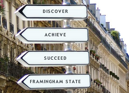 "Road signs reading ""Discover, Achieve, Succeed, Framingham State""."