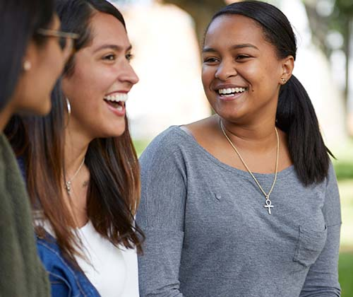 Three female students on campus