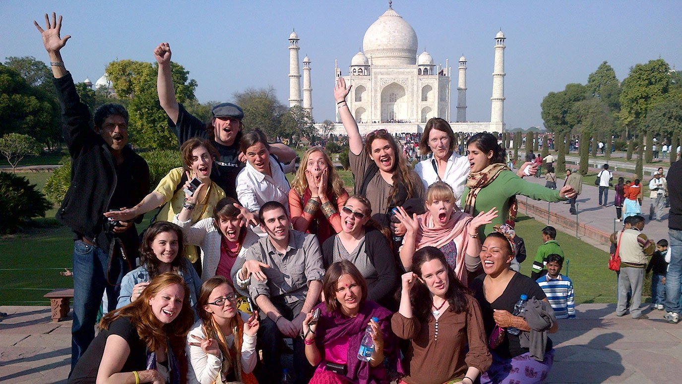 English students posing outside the Taj Mahal