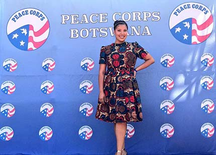 FSU alum Priscilla Moreno poses in front of Peace Corps sign