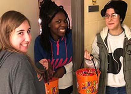 3 students trick or treating