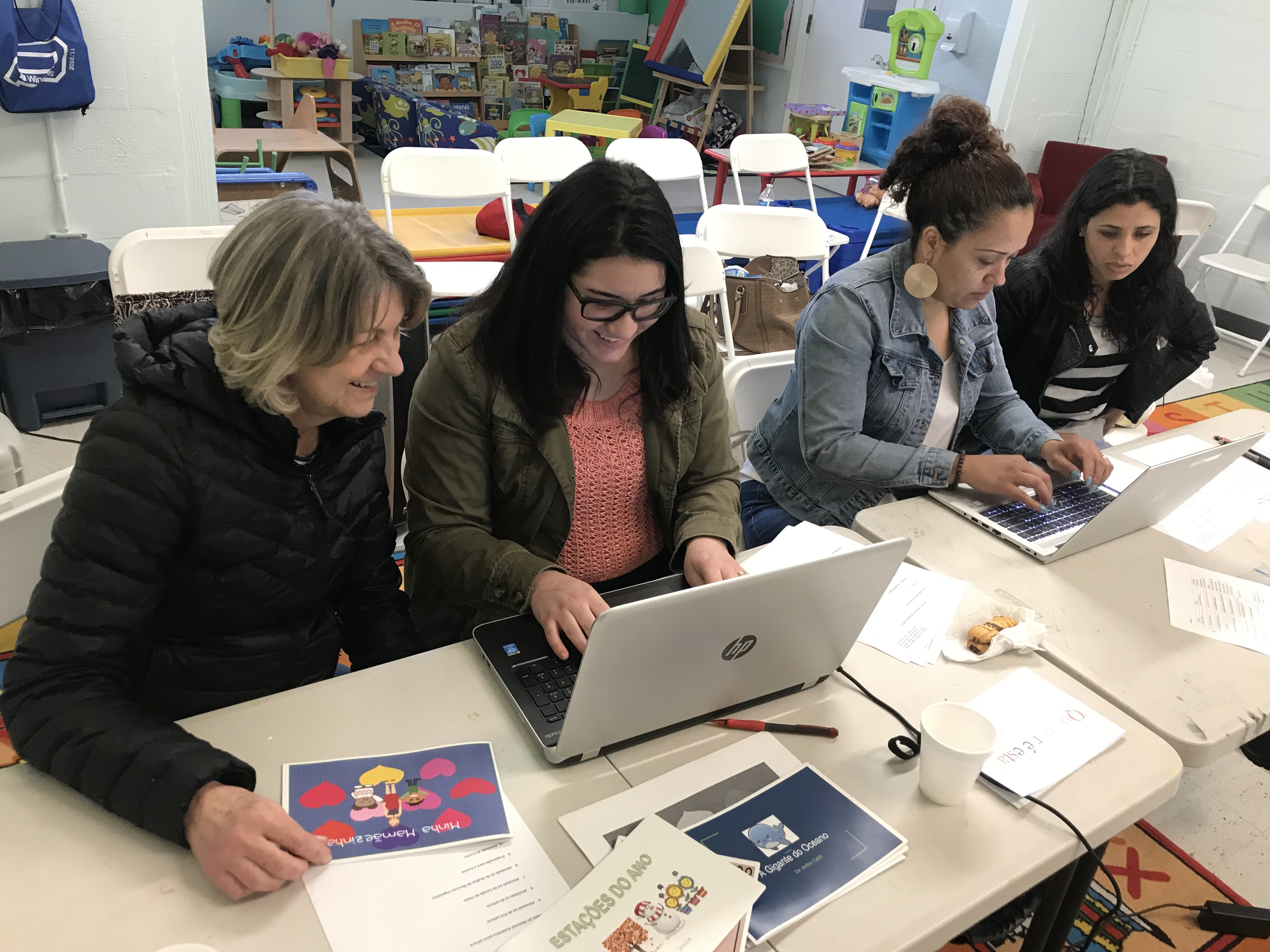 Students and teachers working on children's book